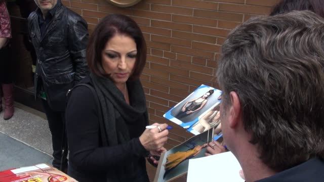 Gloria Estefan poses with fans while departing from The View studio on October 15 2014 in New York City