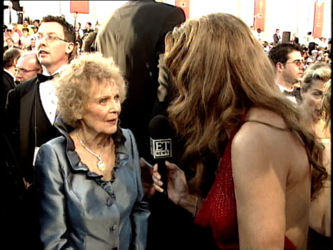 Gloria Stuart talks to reporters on the red carpet at the 70th Annual Academy Awards
