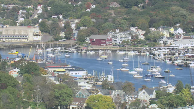aerial gloucester harbor crowded with boats and ships and surrounding coastal properties / gloucester, massachusetts, united states - gloucester massachusetts stock videos & royalty-free footage