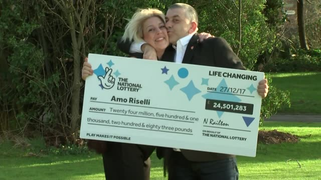 Gloucester taxi driver wins 255 million lottery jackpot ENGLAND Gloucester EXT Amo Riselli presented with cheque / photocall / photocall with wife /...