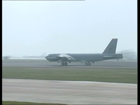 gloucestershire raf fairford us b52 bomber taking off for bombing mission to iraq pan ground to air b52 taking off - raf fairford stock videos and b-roll footage