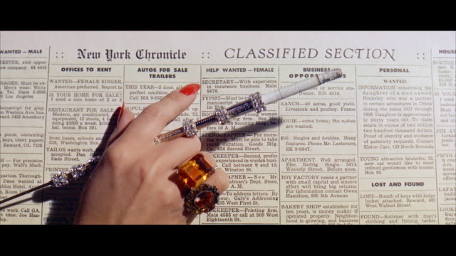 vídeos de stock, filmes e b-roll de cu gloved and jeweled woman's hands  - classified ad