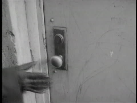 a gloved hand turns a doorknob and opens a door - thief stock videos & royalty-free footage