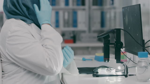 gloves on and ready to work - biochemist stock videos & royalty-free footage