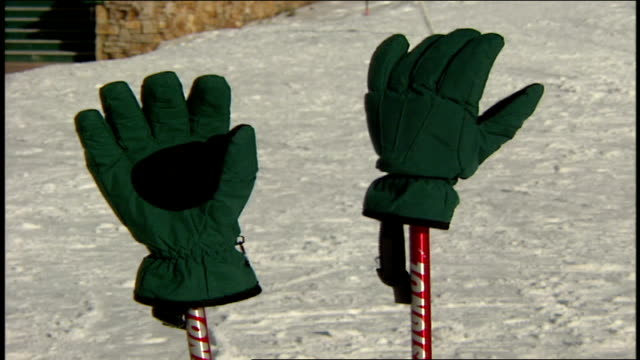 gloves on ski poles standing in snow in telluride colorado - スキーウェア点の映像素材/bロール