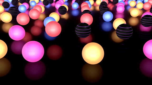 Glowing Colorful Balls Moving Slowly On The Reflective Floor