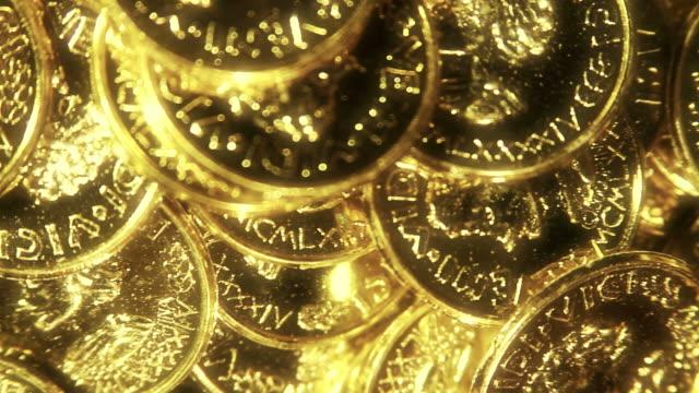 raggiante cavalcavia oro - moneta video stock e b–roll