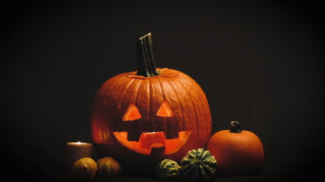 glowing jack o' lantern - pumpkin stock videos & royalty-free footage