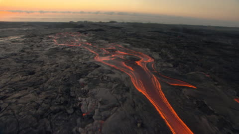 glowing lava flows from volcano at dawn, hawaii - volcano stock videos & royalty-free footage