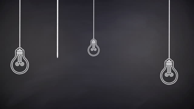 glowing light bulb innovation concept on chalkboard - marketing stock videos & royalty-free footage