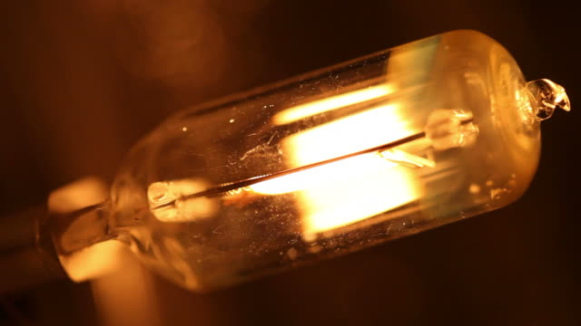 glowing light bulb - energy efficient lightbulb stock videos and b-roll footage