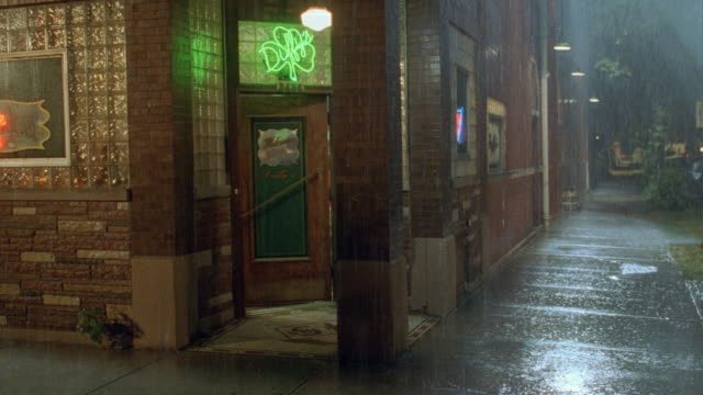 a glowing neon shamrock hangs above the door to duffy's bar in chicago. - western script stock videos & royalty-free footage