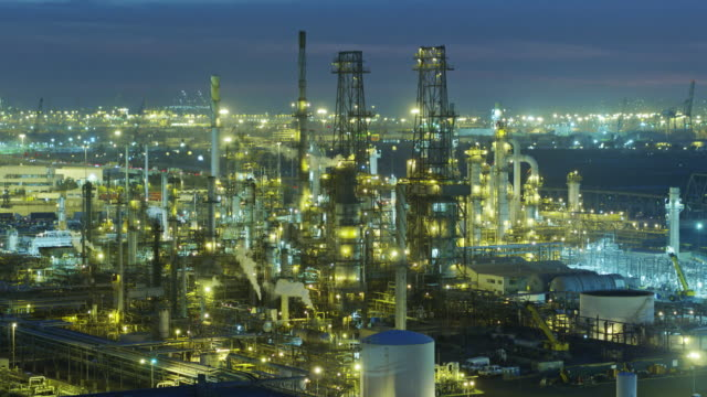 Glowing Oil Refinery Complex - Drone Shot