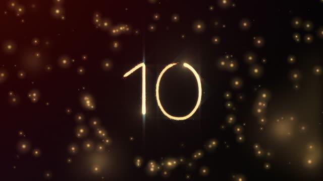 glödande partiklar formar nummer 10 med sfäröppning och röd glödande bakgrund i 3d och bleknar ut - number 3 bildbanksvideor och videomaterial från bakom kulisserna