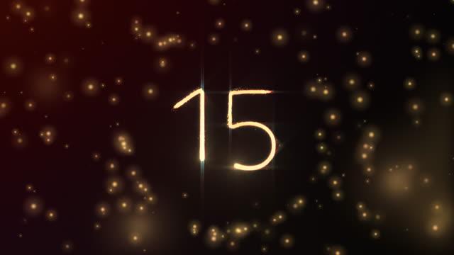 glödande partiklar formar nummer 15 med sfäröppning och röd glödande bakgrund i 3d och bleknar ut - number 3 bildbanksvideor och videomaterial från bakom kulisserna