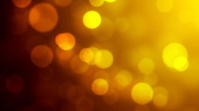 glowing particles  - yellow/gold - spotted stock videos & royalty-free footage
