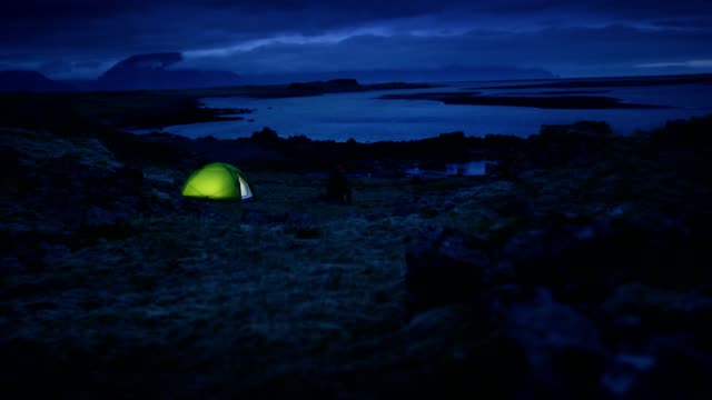 glowing tent under a cloudy sky - tent stock videos & royalty-free footage