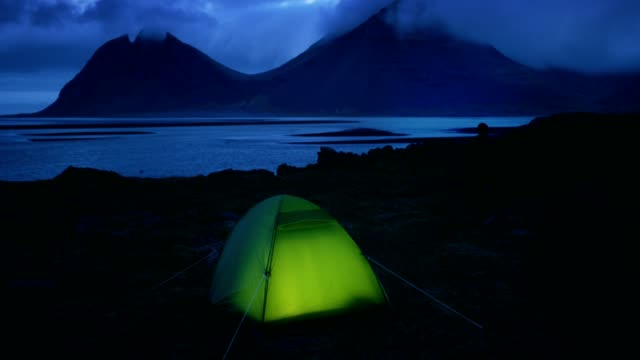 glowing tent under a cloudy sky - glowing stock videos & royalty-free footage