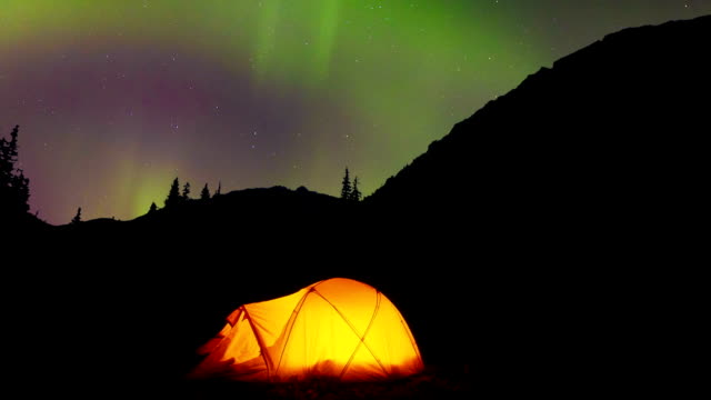 glowing tent under the northern lights - alberta stock videos & royalty-free footage