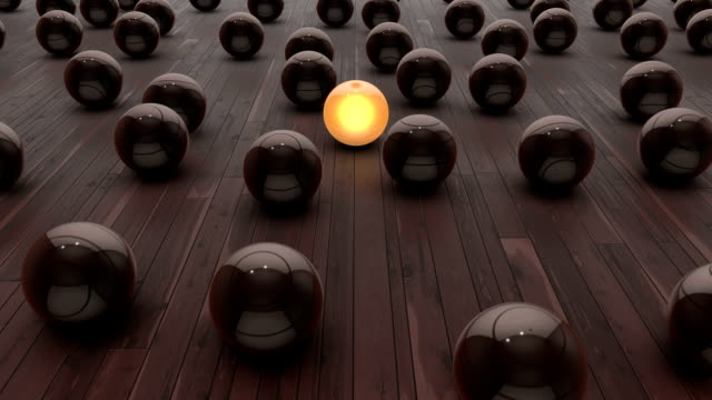 glowing yellow sphere among others - standing out from the crowd stock videos & royalty-free footage