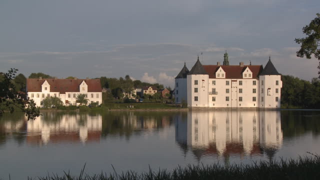 ws, gluecksburg castle seen across water, schleswig-holstein, germany - schleswig holstein stock videos & royalty-free footage