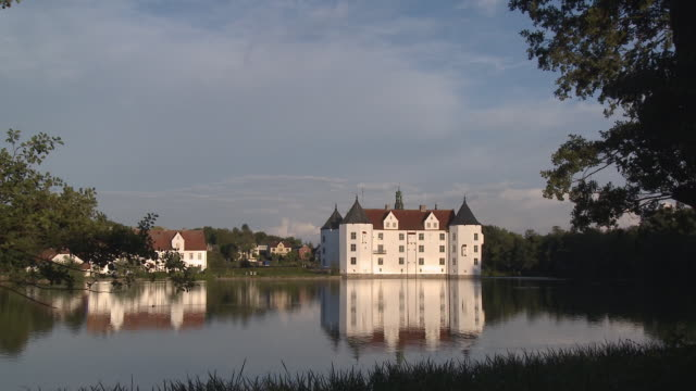 ws, zi, gluecksburg castle seen across water, schleswig-holstein, germany - schleswig holstein stock videos & royalty-free footage