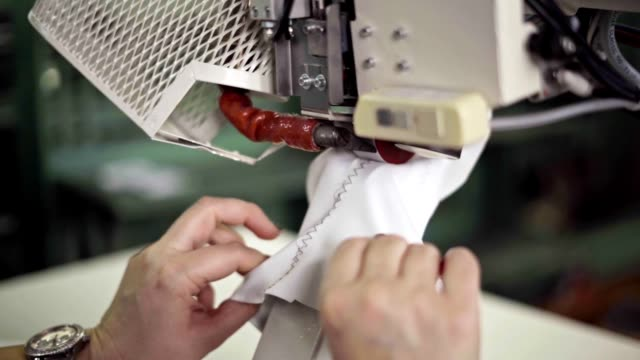 glueing goretex waterproof shoe material - lace textile stock videos & royalty-free footage