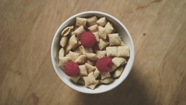 gluten free cereal in a bowl with berries - gluten free stock videos & royalty-free footage