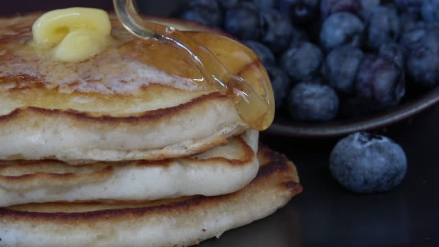 gluten free pancakes with honey and blueberries - gluten free stock videos & royalty-free footage