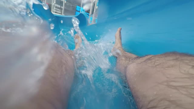 go down a water slide, pov  a waterslide having fun - wasserrutsche stock-videos und b-roll-filmmaterial