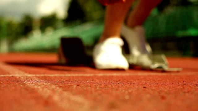 go! - blocco di partenza per l'atletica video stock e b–roll