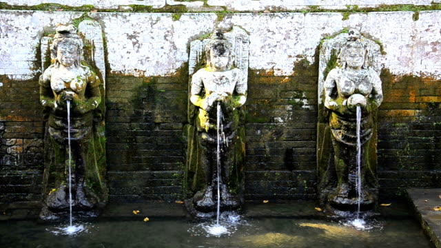 goa gaja holy water in bali, indonesia - sarong stock videos and b-roll footage