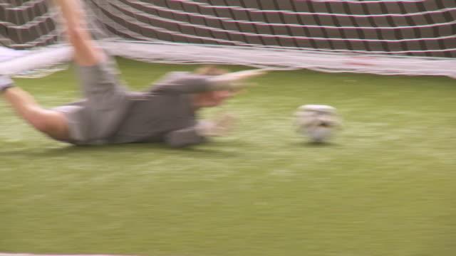 ms goal keeper making saves, london, uk - snabb panorering bildbanksvideor och videomaterial från bakom kulisserna