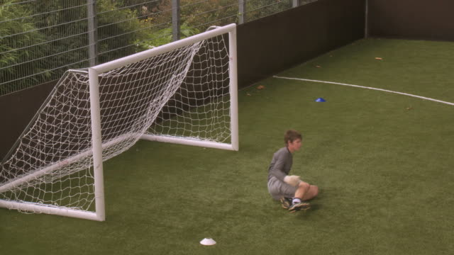 ws goal keeper making saves, london, uk - one teenage boy only stock videos & royalty-free footage