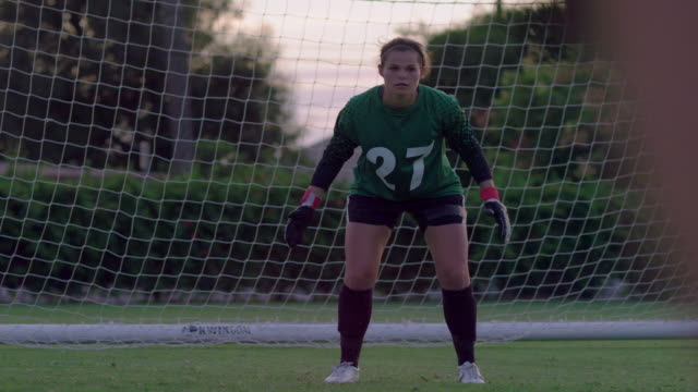 ms slo mo goalie catching soccer ball and back to her teammate / riverside, california, united states - goalkeeper stock videos & royalty-free footage