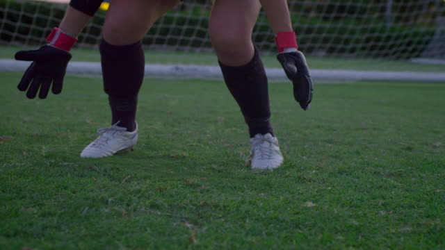 ms slo mo goalie catching soccer ball / riverside, california, united states - goalkeeper stock videos & royalty-free footage
