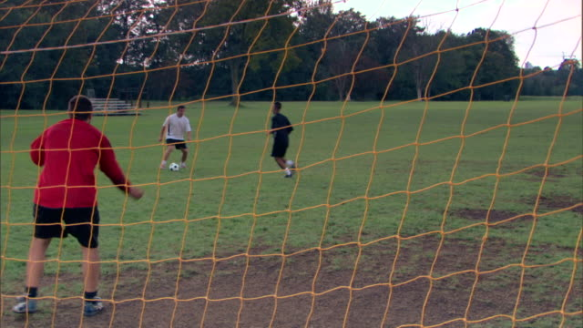 goalie defending soccer goal - see other clips from this shoot 1280 stock videos & royalty-free footage