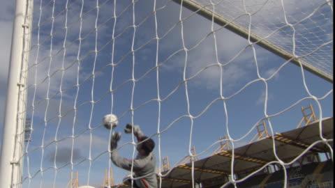 vídeos y material grabado en eventos de stock de la ws goalie jumping and missing soccer ball catch / sheffield, england, uk - portería artículos deportivos
