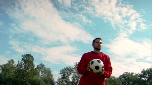Goalie kicking soccer ball