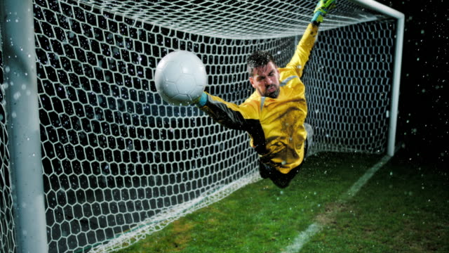 SLO MO Goalkeeper defending the goal