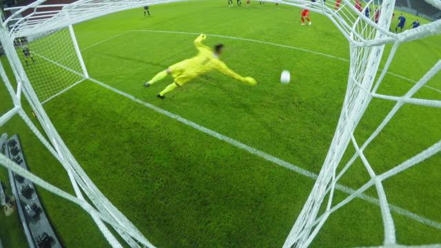 ld goalkeeper fails to defend a penalty kick - ゴールポスト点の映像素材/bロール