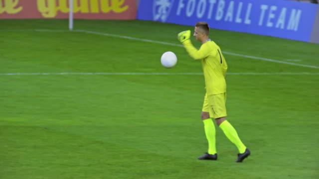 goalkeeper kicking the ball at a football match - goalkeeper stock videos & royalty-free footage