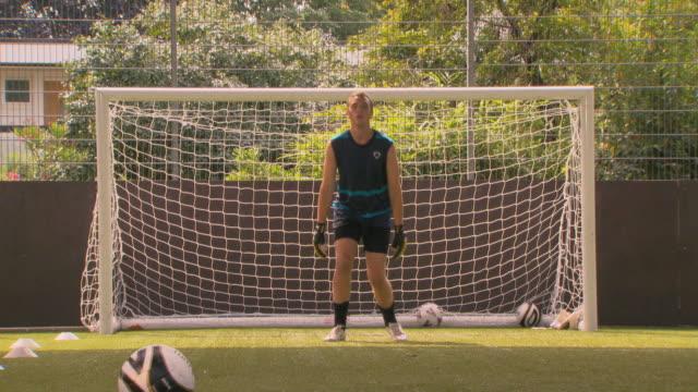 ms goalkeeper making save, london, uk - torschuss stock-videos und b-roll-filmmaterial