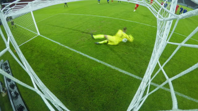 LD Goalkeeper succeeds to defend the goal