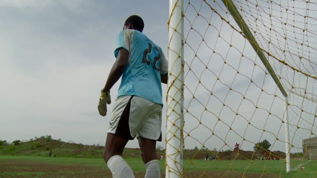 goalkeeper takes position during practice game. available in hd. - ghana stock videos & royalty-free footage
