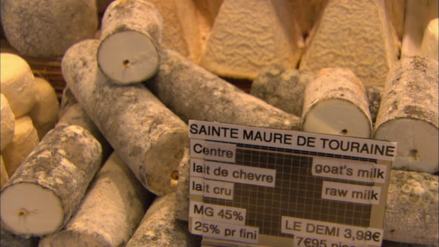 cu goat milk cheese in display case / paris, france - french culture stock videos & royalty-free footage