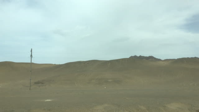 gobi desert, seen from a driving car