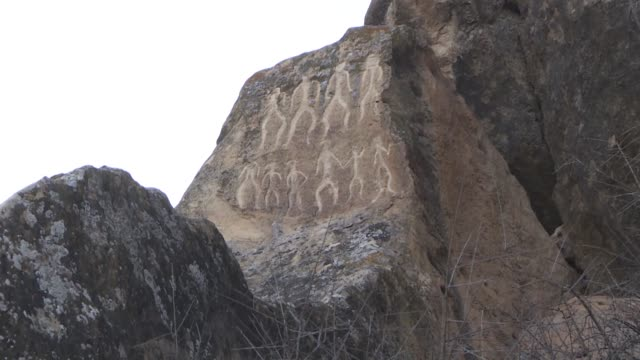 stockvideo's en b-roll-footage met gobustan rock art cultural landscape in azerbaijan is a bridge connecting the past and modern ages, a reserve official told anadolu agency in an... - 40 seconds or greater