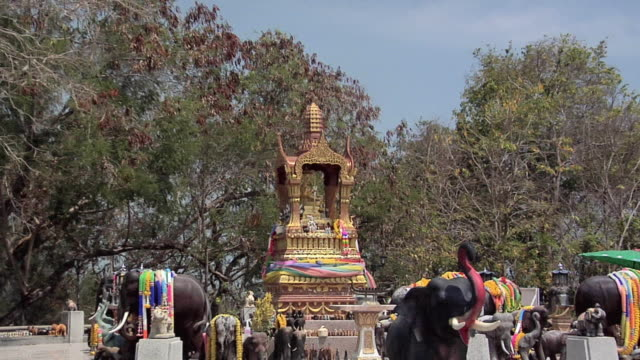 ms zo ws god with four faces surrounded by elephant guards at southern tip of phuket, phuket, thailand - animal representation stock videos & royalty-free footage