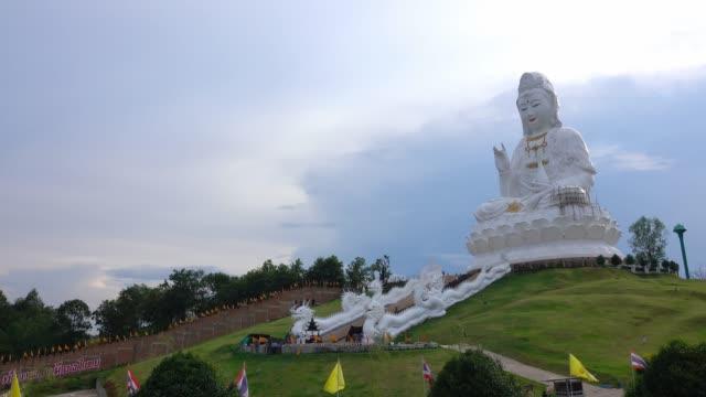 goddess of mercy or guan yim statue at huai pla kung in chiang rai thailand. - guanyin bodhisattva stock videos & royalty-free footage